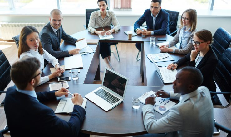 Businespeople at panel discussion in board room